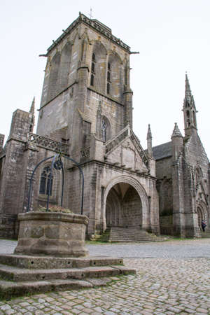 cited: The church of Saint Ronan, Chapel Pénity and well on the place in Locronan Finistere in Brittany - France