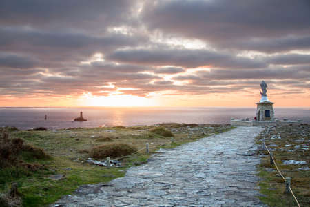 Nightfall on the statue of the Pointe du Raz in Brittany - France photo
