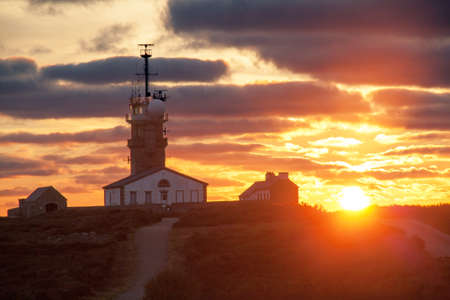 Sunset on the semaphore of the Pointe du Raz in Brittany Brittany - France photo