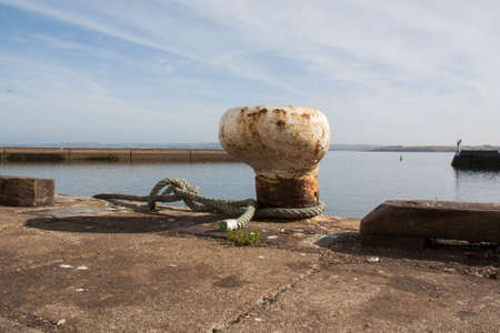 Mooring bollard on a quay of Douarnenez in Finistère in Brittany - France
