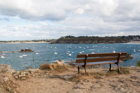 cotes d armor: Bench facing the sea in St  Lunaire in Brittany Cotes d Armor - France