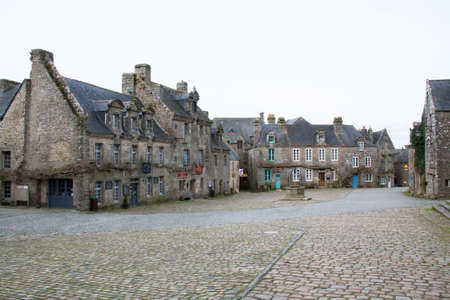 cited: Village Square Locronan, town character, in Finistre in Brittany - France