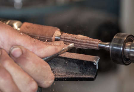 wood turning: Creation of a pen by turning on a lathe wood Stock Photo