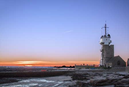peron: Sun setting over the lighthouse Penmarc