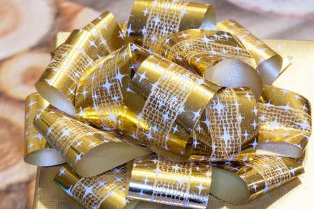 ribbon bow: Gold ribbon bow Stock Photo