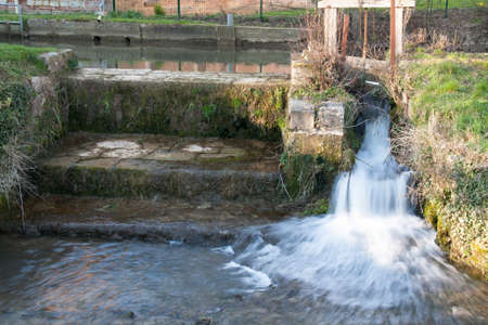 withholding: Small waterfall and water retained on a small river