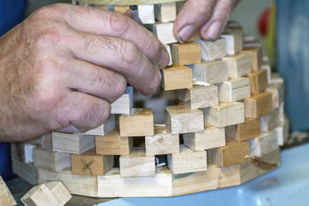 carpenter's bench: Assembling the parts before the production of  'a vase on a wooden tower Stock Photo