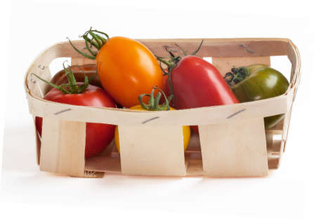 yesteryear: Old tomato tray packed in different colors on a white background