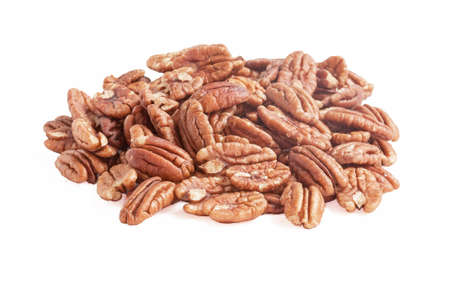 dietetics: nuts in a heap on white background