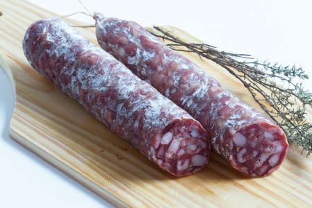 dry sausage: Dry sausage on cutting board Stock Photo