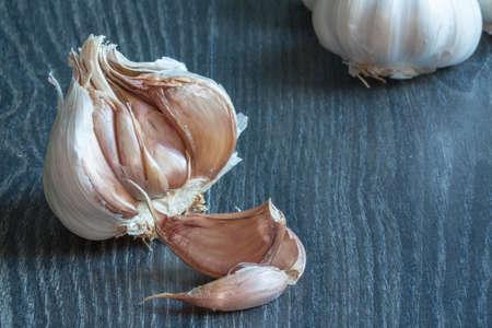 epicurean: Heads of garlic on a dark background
