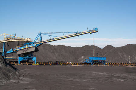 conveyor rail: Storage of coal and industrial site on treadmill Stock Photo