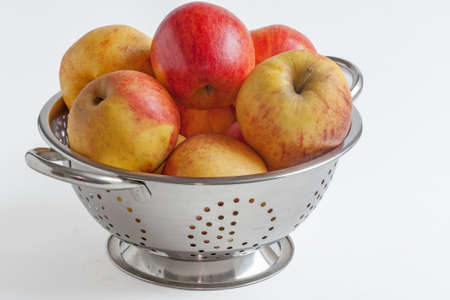 skimmer: Different varieties of apples in a skimmer on white background
