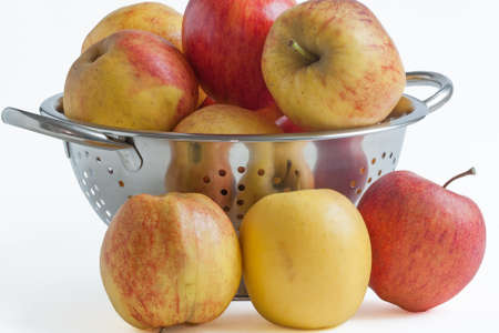 varieties: Different varieties of apples in a skimmer on white background
