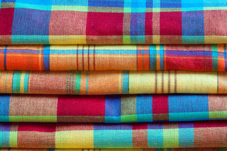 Madras: Madras tablecloths are folded and stacked ? ? es, tradition of Caribbean islands Stock Photo