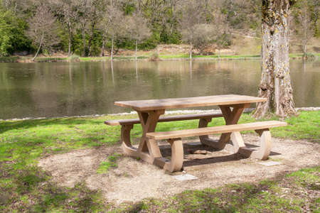 waters  edge: Table and benches at the waters edge Stock Photo