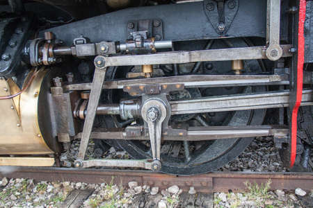 linkage: Wheels and linkage of steam locomotive, monument Stock Photo