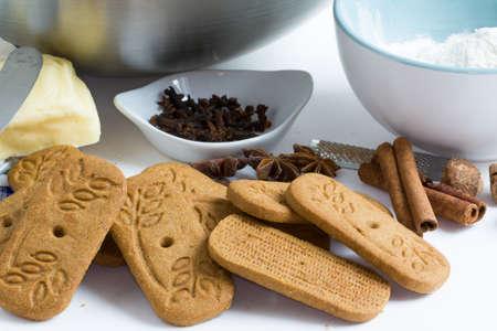 saint nicolas: ? Spec culoos heap and Ingra ? ingredients manufacturing dark background Stock Photo