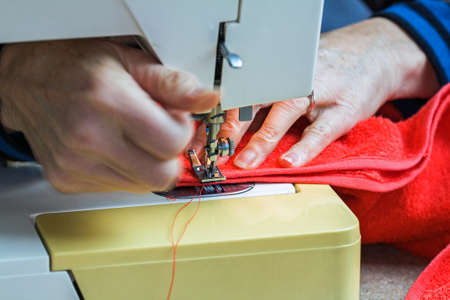 Couturi�re working on sewing machine