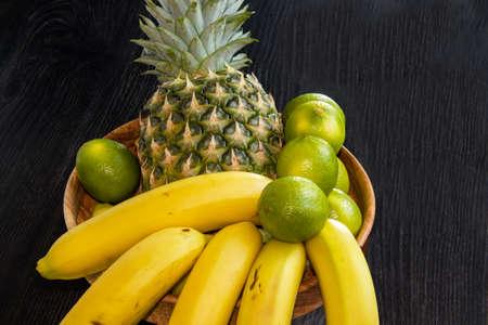 exotic fruit composition on black background