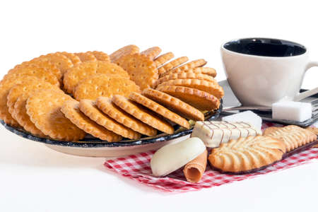 Snack with Breton pancakes and assortment of cakes on a white background