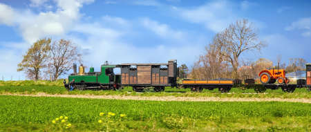 Steam locomotive in the countryside behind a field, Baie de Somme, Hauts de France