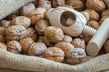 Loose nuts in a burlap bag with nut casing homemade Imagens