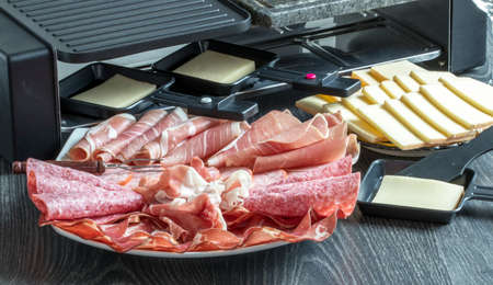 Various cold cuts and cheese for raclette