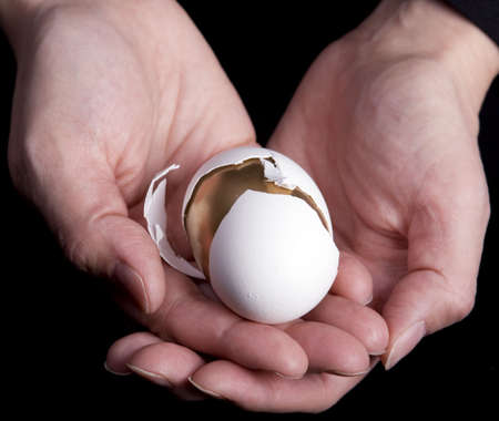 Hands holding golden egg Banco de Imagens