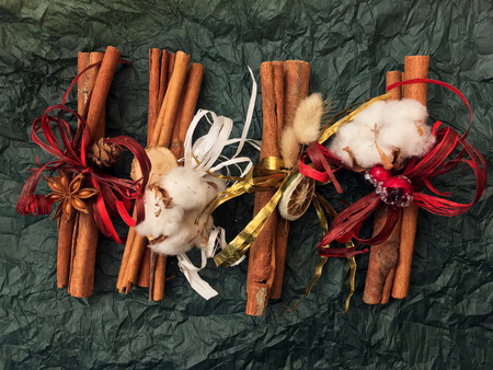 Traditional Christmas spices - Star anise with cinnamon and cloves on background.