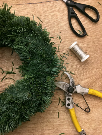 Things to manufacture Christmas wreaths on wooden table. 写真素材