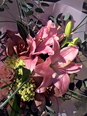 Close-up Beautiful Bouquet. Bouquet of flowers tulips, spray rose, pink lily. Beautiful bright flowers background. 版權商用圖片