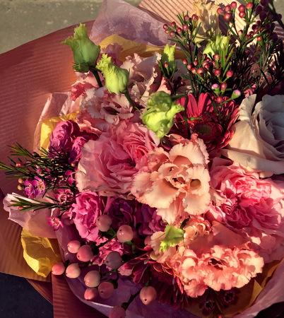 Close-up Beautiful Bouquet. Bouquet of flowers pink hamelacum, pink Eustoma, pink spray rose, pink hypericum berries , gerbera. Beautiful bright flowers background. 版權商用圖片