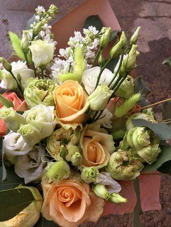 Close-up Beautiful Bouquet. Bouquet of flowers white lilac, white Eustoma, orange rose. Beautiful bright flowers background. Beige bouquet Reklamní fotografie