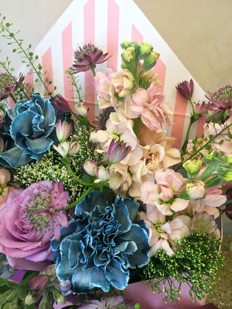 Composition with Colorful. Flowers pink matthiola, white Ranunnculus, eucalyptus Astrantia, blue carnation, purpl roses 版權商用圖片