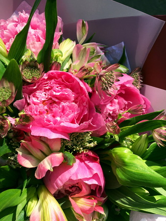 Close-up Beautiful Bouquet. Bouquet of flowers pink peony and pink alstroemeria and green leaf, Astrantia.