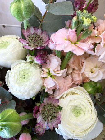Composition with Colorful. Flowers pink matthiola, white Ranunnculus, eucalyptus Astrantia