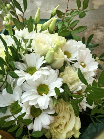 Close-up Beautiful Bouquet. Bouquet of flowers white chrysanthemum, white roses green leafs. Beautiful bright flowers background. 版權商用圖片