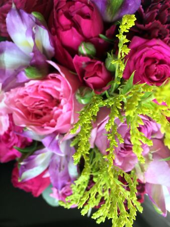 Close-up Beautiful Bouquet. Bouquet of flowers solidago, freesia, pink roses, pink dianthus. Beautiful bright flowers background. Banco de Imagens
