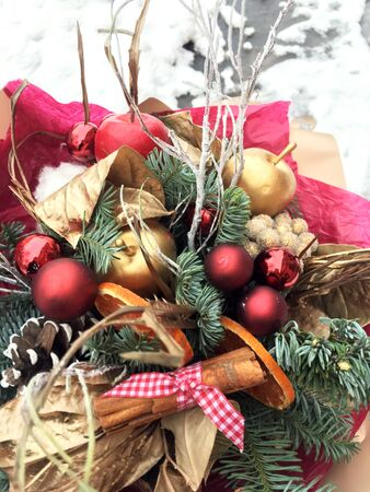 Christmas bouquet . Winter bouquet t of fresh Nobilis, gold apple, red ball. A bouquet of nobilis, cinnamon, fir branches, cones and gold ball.
