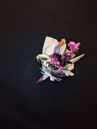 Beautiful dry flower bouquet on black background. Banco de Imagens