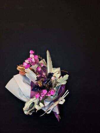 Beautiful dry flower bouquet on black background. Banque d'images - 132125369