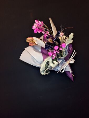 Beautiful dry flower bouquet on black background. Banque d'images - 132125596