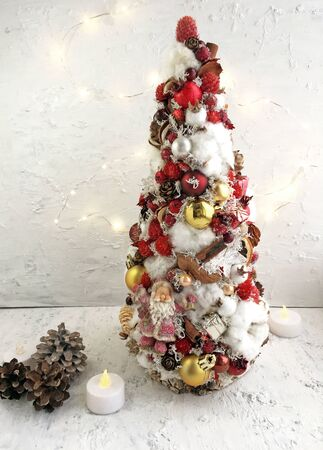 Creative Christmas tree handmade, white, red and gold Christmas tree. Christmas tree decor in macro. Christmas tree background.
