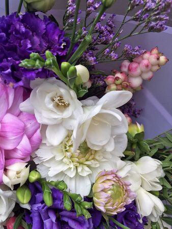 Beautiful bouquet flowers. Pink dahlia, white alstroemeria and blue flowers. Flowers background.