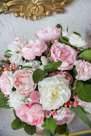 Bridal bouquet of preserved flowers. Wedding bouquet of preserved flowers in white and pink shades with silk ribbon.