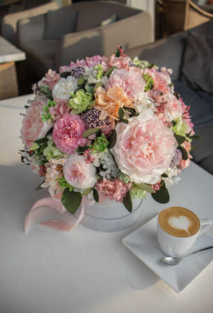 Beautiful delicate pink and white flowers in hat gift box gray color.