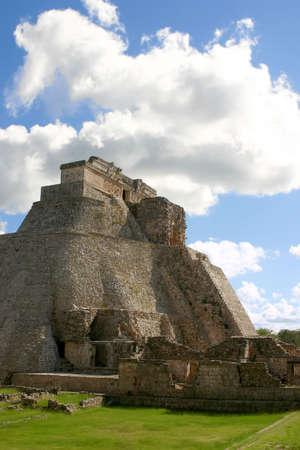 Main round pyramid on mayan site over sky photo