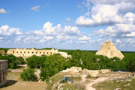 Maya ruins Uxmal in mexican Yucatan with green forest Stock Photo