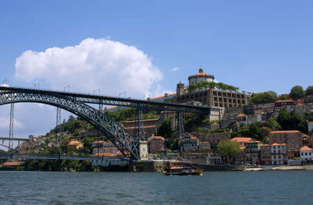 Antique fortress with bridge in Porto over blue sky